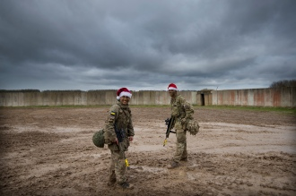 Mcc0080291 © Eddie Mulholland PIC: Private Piers Smedley (4th Battalion) and Lance Corporal Paul Brien (3rd Battalion) Princess of Wales's Regiment. Ex SNOW TIGER 2017 ARMY'S RESERVE TROOPS' CHRISTMAS LUNCH IN THE FIELD Army Reserve troops from the 3rd and the recently formed 4th Battalion, Princess of Wales's Royal Regiment combined for their final training exercise of 2017 on Salisbury Plain. Their target was to seize the village of Copehill Down and their prize, a slap up four-course Christmas lunch served to them in field conditions by their officers. In time honoured British Army tradition a soldier's Christmas dinner is the one time in the year they can relax and put their feet up as their officers serve them their festive fayre. So, having fought their way house to house and captured their objective of the village of Copehill Down - a purpose built military training complex that tests troops at fighting in an urban setting - 200 exhausted mud caked soldiers from the two Reserve battalions of the Princess of Wales's Royal Regiment laid down their machine guns, grenades and bullets to be treated to an all-the-trimmings Christmas meal complete with crackers and silly hats! The 4th Battalion, Princess of Wales's Royal Regiment is one of the newest Arrny Reserve infantry battalions having been formed earlier in the autumn of 2017. With its Headquarters in Crawley it has Company locations in: Portsmouth, Farnham and London.