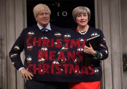 Mcc0080511 © Eddie Mulholland Boris Johnson and Theresa May come together at Madame Tussauds London for the first time to celebrate Save the Children's Christmas Jumper Day