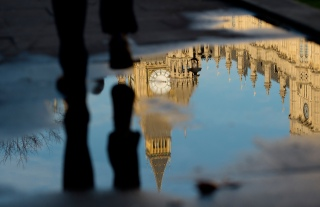 Mcc0074795 ©Eddie Mulholland The Palace of Westminster reflected in a puddle in Westminster after Theresa May made a major speech on Brexit at Lancaster House today.